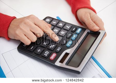 Close-up of woman hands with calculator. Female financial adviser forecasting corporate budget.
