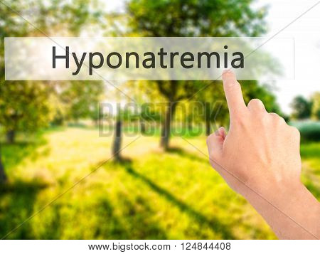 Hyponatremia - Hand Pressing A Button On Blurred Background Concept On Visual Screen.