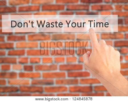 Don't Waste Your Time - Hand Pressing A Button On Blurred Background Concept On Visual Screen.