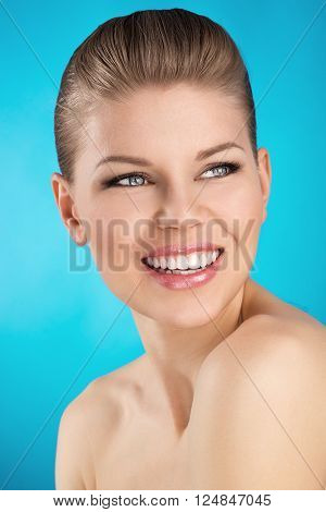 Beauty portrait of smiling girl. Dental care concept.