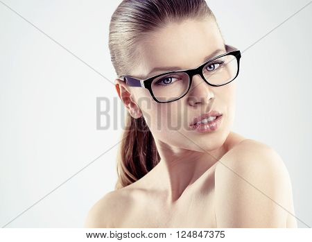 Close-up portrait of young attractive woman optician in eyewear
