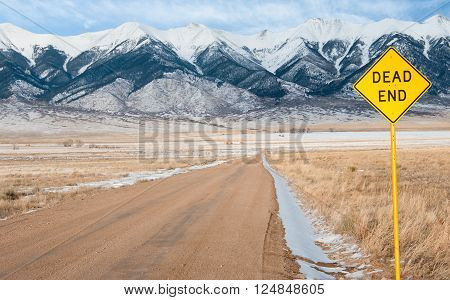 Dead End Sign:  A sign warns of an impasse ahead on a gravel road in central Colorado.