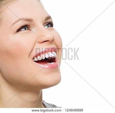 Dental cure. Teeth whitening. Caries prevention. Happy smiling girl showing her healthy bright teeth.