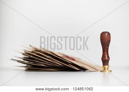 Pack of letters with old style stamp for sealing wax