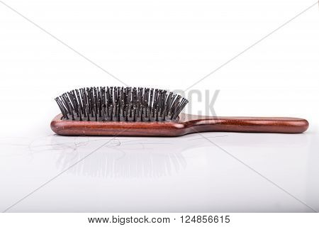 Comb With Strand Of Hair On White Background