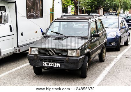 OVADA, FRANCE - AUGUST 7, 2014: Compact motor car Fiat Panda in the city street.