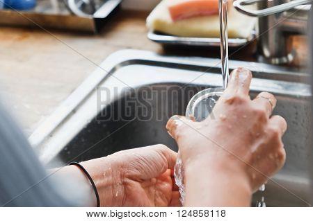 House Work,Close up image of washing dishes.