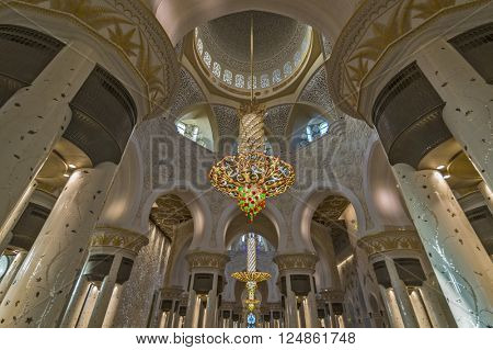 ABU DHABI, UAE - MARCH 12: Chandeliers hanging from the ceiling in the Sheikh Zayed Grande Mosque on March 12, 2016 in Abu Dhabi. Sheikh Zayed Grande Mosque is the third largest mosque in the world
