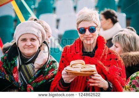 Gomel, Belarus - March 12, 2016: Two unknown beautiful women in national folk clothes at Celebration of Maslenitsa Shrovetide holiday