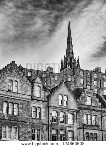EDINBURGH, SCOTLAND - MARCH 7: Block of flats and the steeple of The Hub in the Old Town of Edinburgh at March 7, 2106