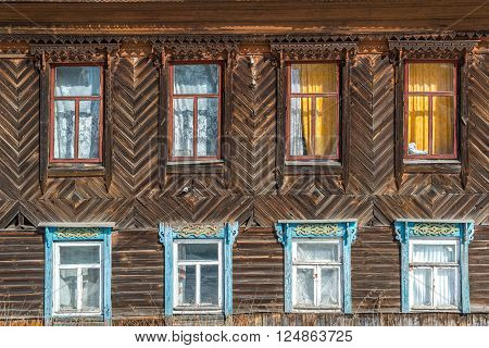 Carved window in an old russian wooden country house