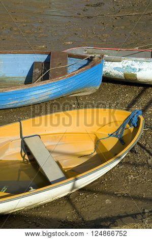Boats moored at low tide on the coast near Morston, North Norfolk, UK.