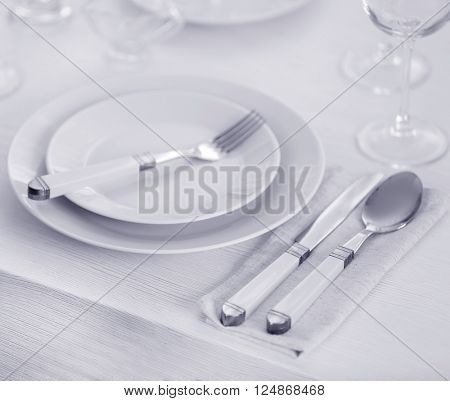 Table setting with plates and cutlery