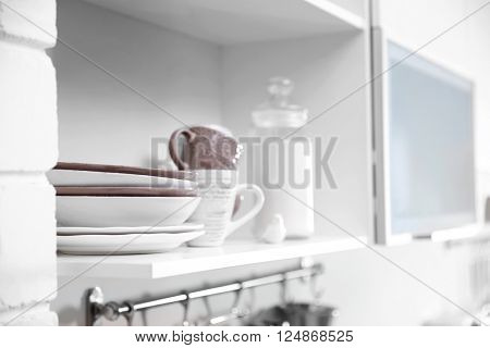 Dishware on a kitchen shelves