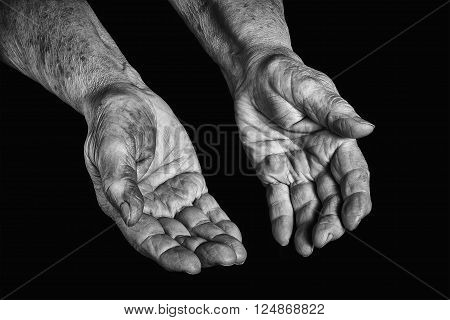 Senior woman hands open on a black background