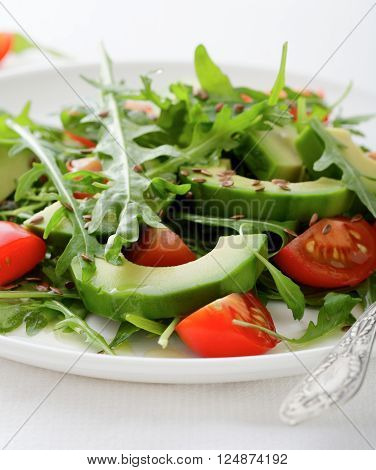 Salad With Avocado, Cherry Tomatoes And Arugula Closeup
