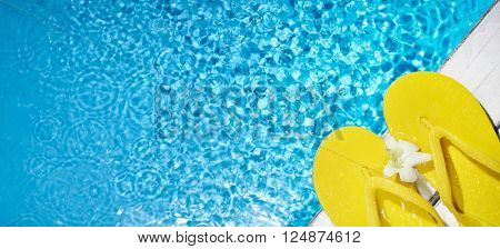 Flip flop on the side of a swimming pool
