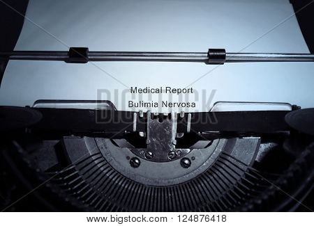 Old typewriter and inserted white sheet of paper with medical report on bulimia