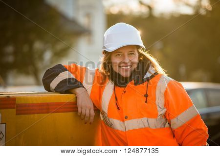 Portrait of senior woman engineer helmet wearing protective wear - outdoor