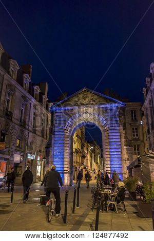 Bordeaux, France - March 27, 2016. Men in bike rolling in Porte Dijeaux. Dijeaux is a city gate in Gironde district of Bordeaux, capital of Aquitaine. France.