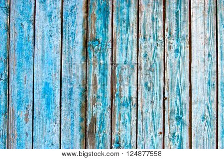 Dirty, stained by a paint the hammered together fence