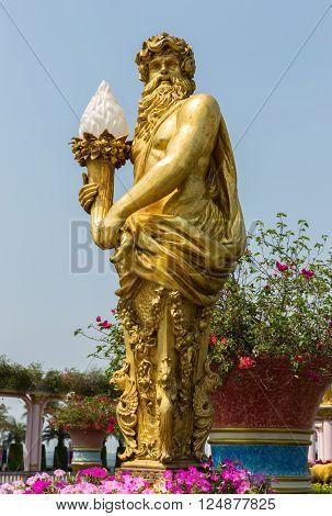 Golden sculpture of Zeus in the park