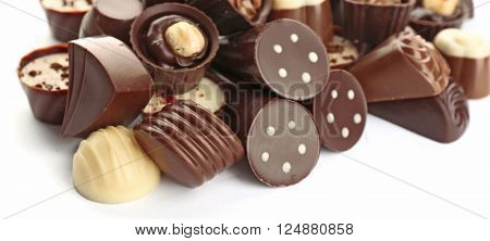 Assorted chocolate candies, isolated on white