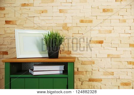 Bedside-table and home decor on a brick wall background