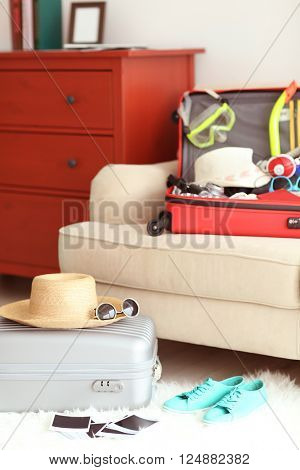 Woman's clothes in a red suitcase, close up
