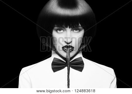 Sexy dominant woman in wig bite whip black and white bdsm