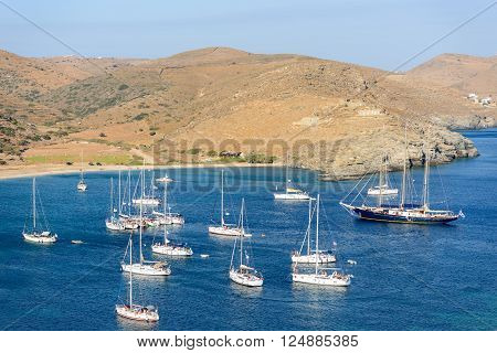 KYTHNOS GREECE - AUGUST 12 2014: Sailing boats anchored offshore at Fykiada beach next to the famous Kolona beach