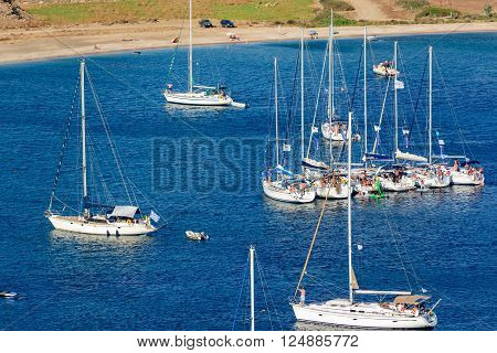 KYTHNOS, GREECE - AUGUST 12, 2014: Sailing boats raft-up at Fykiada beach next to Kolona beach