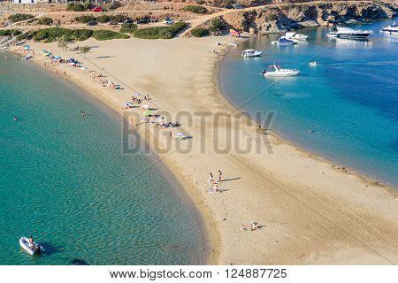 KYTHNOS GREECE - AUGUST 12 2014: The Kolona double sided beach at Kythnos Greece as viewed from Aghios Loukas islet