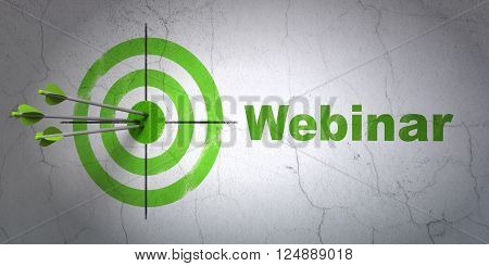 Education concept: target and Webinar on wall background
