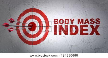 Health concept: target and Body Mass Index on wall background