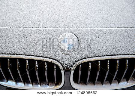 PARIS FRANCE - JAn 20 2016: BMW Car logo (Bayerische Motoren Werke AG) logotype covered with snow flakes.