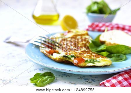 Omelet With Tomatoes And Spinach.