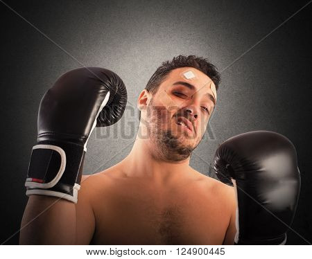 Boxer with bruises and bandages on face