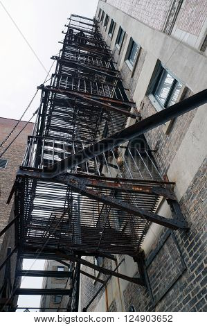 A fire escape on the side of a tall apartment building in downtown Joliet, Illinois.