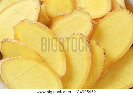 detail of sliced raw potatoes in white bowl