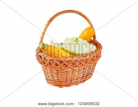 Zucchini and pattypan in basket isolated on a white background