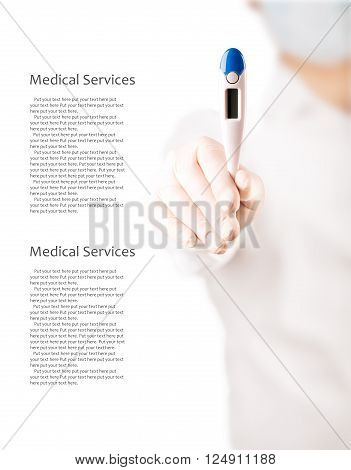 Doctor holds an electronic thermometer for temperature measurement (with copy space)