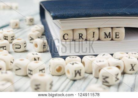 Crime word written on wood block. Wooden ABC.