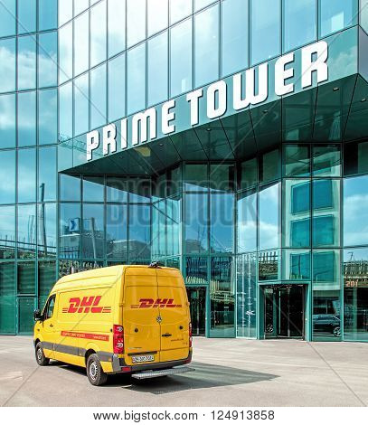 Zurich, Switzerland - 4 April, 2016: entrance of the Prime Tower building with a DHL van parked near it. The Prime Tower is a skyscraper located near the Hardbruecke railway station. Being 126 meters high it is the highest skyscraper in Switzerland.