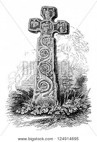 Norman cross placed in the courtyard of the Church of Eyam, vintage engraved illustration. Colorful History of England, 1837.