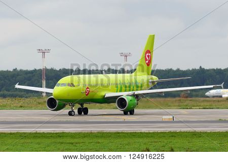 MOSCOW, RUSSIA - JULY 20: Aircraft operated by S7 Airlines taxiing to runway at Moscow airport in Domodedovo on July 20 2013. The company in its fleet has 20 aircraft Airbus-A319