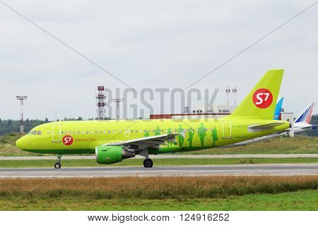 DOMODEDOVO RUSSIA - JULY 20: Aircraft operated by S7 Airlines readi to take off at Moscow airport in Domodedovo on July 20 2013. The company in its fleet has 20 aircraft Airbus-A319