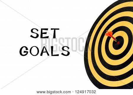 Words set goals and dart target with arrow on bullseye, Goal target success business investment financial strategy concept, abstract background