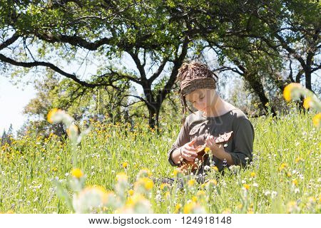 Cute Young Girl With Ukulele in Green Grassy Field