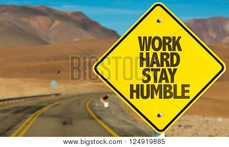 Work Hard Stay Humble sign on desert road